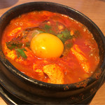 韓国料理Bibim - 生卵を入れたらまろやかに〜♪