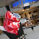 63574050 - ブラックコーンソフトクリーム  ピーチ&ミルク(ラズベリーソース)