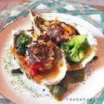 63626179 - 牡蠣と白葱のソテー 焼きリゾットのせ