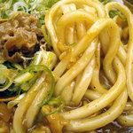 得正 - 「名物カレーうどん」カレーに絡んだ極太麺