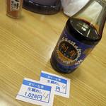 まりーな亭 - 卓上には刺身醤油と七味