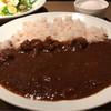 スパニッシュバル クク - 料理写真:半熟玉子牛すじカレー 900円。