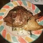 63761867 - 鯛のカマの香草ピザ釜焼き