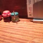 64043369 - 卓上   酢醤油に赤 ラー油  緑 柚子胡椒