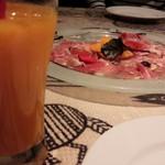 洋食・ビアホール ノマド - マンゴージュースと生ハム