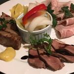 64124437 - 自家製ロースハムの塩漬け                       豚肉の煮こごりを焼いたもの                       フォアグラを取った後の鴨肉の燻製