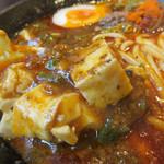 大名ちんちん - 痺れる山椒粉がたっぷりかかった麻婆豆腐。