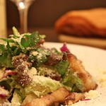 熟成肉×Bistro OGINO - 燻製した「岩中豚」を使ったシーザーサラダです。 レシピをお客様に何度も尋ねられる、当店人気のドレッシングで。