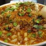 麺屋武蔵 巖虎 - たまに行くならこんな店は、秋葉原真っ只中で真っ赤っ赤な豆腐inラーメンが楽しめる「麺屋武蔵 厳虎」です。