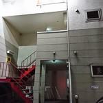 64515167 - 赤い階段を上がった2階の奥にあります
