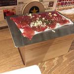 肉バルGABUTTO - お通しのアンガス牛熟成生ハム(¥390+外税)