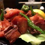 焼鶏あきら - 薩摩赤鶏骨付きベーコンの唐揚げ