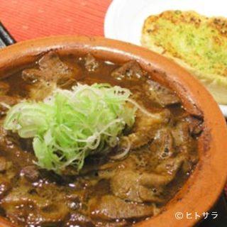 ガーリックトーストで食べる【牛もつ煮】