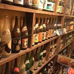 でーびる沖縄 - お店の入口。泡盛の瓶が圧巻です。