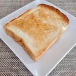 ミクスチャー - 食パン 1斤@280円 5枚切りの1枚       はちみつをかけて。