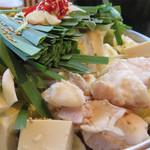 博多空とぶ豚  - 本日のメインのもつ鍋です。 極しょうゆ味と自家製明太味がありますが、今回はオーソドックスな醤油味にしました。