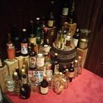 65577056 - お店入口に置いてあるお酒の瓶も良い雰囲気