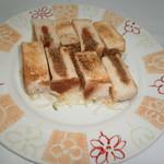 大衆居酒屋 和楽 - タコスミートパン包み焼き
