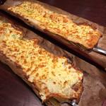 居酒屋 NIJYU-MARU - 【花まるコース】全8品・飲み放題付き@4000円の 《もっちりチーズピザ》