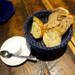 65889580 - お通しのパンとスモークバター300円x2+税