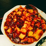 餃子・王 - 四川料理を謳うお店ながら麻辣は控えめ。