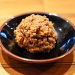 田中商店 - 赤オニ。田中商店オリジナルの辛子ひき肉。これにスープを足してつけ麺風に。ラーメンに投入してもうまい。
