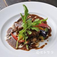 モキチ・フーズガーデン - 熊沢酒造直営レストランの定番メニュー『モキチ特製! こめ豚の湘南ビール煮込み』