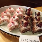 66257815 - 桜ロール@桜の寒天のような層が巻かれていました、ショコラマロンロール@ちょっと乾燥気味