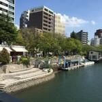 66435583 - 元安川沿いに建つオープンカフェ