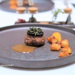 66494418 - 仔羊のハンバーグ  黒ニンニクのピューレ  ローズマリーとケッパー  仔羊から取った出汁のソース  ローズマリーで燻製したジャガイモ  パプリカとヨーグルトのソース