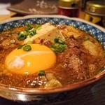 66524921 - 【牛煮込み豆腐】とろとろに煮込まれた牛肉に卵が絡んで旨し。ご飯に掛けて食べたい。