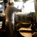 66552365 - 今日も大量生産。大釜で煮込むスープ