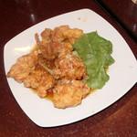 長秀龍 - 料理写真:鶏もも肉揚げニンニクソース