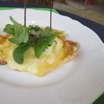 レストランポンム - 魚料理は白身魚の玉子包み。