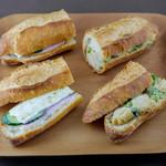 66705290 - 左から、カマンベールチーズとロースハムのカスクルートサンド ホタテと菜の花のサンド