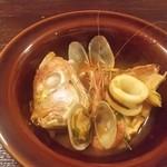 66896277 - 鯛と海老とイカのトマト鍋(取り分け)
