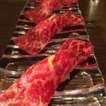 67022802 - 特製赤身肉の燻製醤油握り