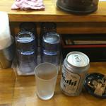 麺屋 Rock - 缶ビールとサービスのおつまみ