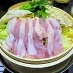 67613042 - 大山鶏と旬野菜の蒸篭鍋(蒸す前)