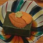 67688132 - お通しの胡麻豆腐雲丹のせ