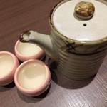 軍鶏専門個室 東京しゃ門 - お通し       鶏出汁スープ