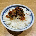 67818321 - 屯ちん川崎店(無料サービスのご飯にon the 辛子高菜)