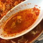 67835760 - 激辛のスープをすくうとこんな。