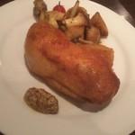 欧風カレー ソレイユ - 骨付きもも肉のコンフィ