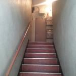 68027174 - この階段の先にあります。
