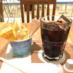 68249560 - パルフェフロマージュメロン&アイスコーヒー。