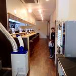 濃厚担々麺 はなび  - 店内風景①。入口から中に入ると意外な奥行きを感じる。