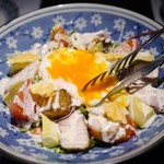 68612112 - 炭火焼きベーコンと温泉卵のシーザーサラダ(温玉を崩します~)