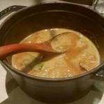 68669557 - もつカレーつけ麺のつけ汁です。