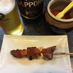 かしら屋 - 瓶ビール(大瓶)550円&カシラ